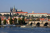 Ships on the Vltava river with Charles Bridge and Prague Castle behind