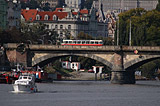 Tram crossing Prague's bridge